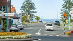 Tauranga NZ City Street with Families Walking and Cars Driving Stock Footage
