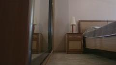 Sliding door mirror wardrobe in modern hotel bedroom interior Stock Footage