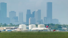 Houston Hobby Airport with Delta Regional Jet and City Background Stock Footage