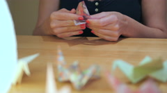 Shot of Girl Hands Folding Crane Origami Stock Footage