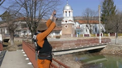 Participant in mummer's ritual shoots with antique gun. Turia - Bulgaria, Europe Stock Footage