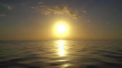 SLOW MOTION: Amazing golden sunset over the calm ocean Stock Footage