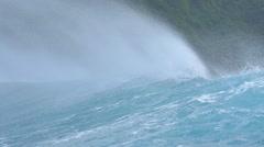SLOW MOTION CLOSE UP: Big wave splashing towards exotic island Stock Footage