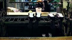 View of worker puts glue on rubber sole Stock Footage