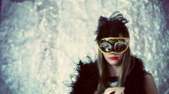 Woman wearing black, carnival mask and looking thoughtful Stock Footage