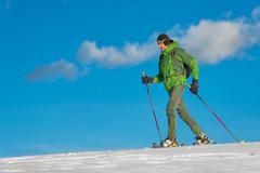 Beautiful shot of hiker in mountain in winter season. Stock Photos