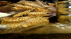Bread, sheaf of wheat ears and flour  on a wooden table, dolly Stock Footage