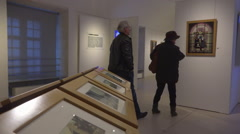 Retired people, mature couple visiting museum, art exhibition - panoramic 3 Stock Footage