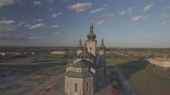 Aerial shot cathedral camera circle around during sunset - stock footage