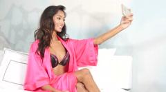 Sexy ethnic girl self potrait in lingerie - selfie fun Stock Footage