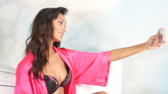 Ethnic Indian Lingerie girl taking selfies with smart phone Stock Footage