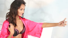 Indian lingerie woman taking self portrait with mobile phone - selfie Stock Footage