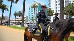 Santa Monica Horse Police Department patrols park in Los Angeles Stock Footage