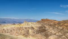 Manly Beacon rock Badlands Zabriskie Point Panamint Range behind Death Valley - stock photo