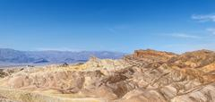 Stock Photo of Manly Beacon rock Badlands Zabriskie Point Panamint Range behind Death Valley