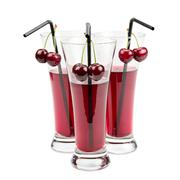 Glasses of cherry juice Stock Photos