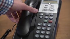 Joining Conference Call on Office Phone Stock Footage