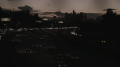Los Angeles Freeway 3 and Skyline at Sunset - Film Log Stock Footage