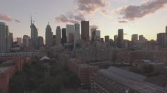 Aerial shot East Toronto looking downtown camera pulling away during sunset Stock Footage