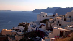 Oia village, Greece. Santorni caldera and cave houses in eveningh light. Stock Footage