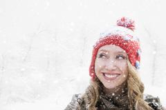 Stock Photo of Woman in red knit hat looking away