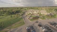 Aerial shot golf club camera circling around during sunset Stock Footage