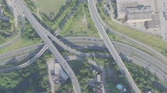Aerial shot highway exit camera pointing down rotating during sunny day Stock Footage