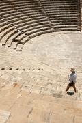 Tourist woman walking around ancient amphitheatre Stock Photos