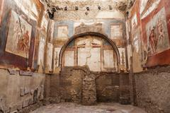 Old mural on walls of ruins of Herculaneum Stock Photos