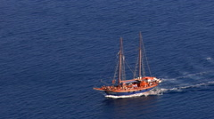 Santorini caldera, Greece. Zoom out form a yacht sailing to the port of Oia. Stock Footage