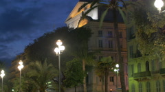 Tilt up view of buildings on Promenade des Anglais in Nice at night - stock footage