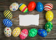 Easter eggs gift card on wooden background - stock photo