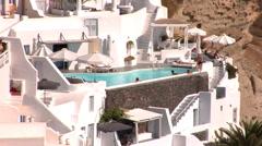 Santorini Island, Greece. Tourists enjoying a pool in a luxury resort in Oia. Stock Footage