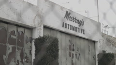 East Los Angeles Abandoned Automotive Shop - Film Log Stock Footage