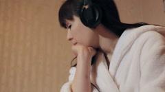 girl in headphones - stock footage