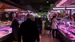 POV camera walk through meat and sausage department of Spanish indoor market Stock Footage