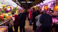 POV move through local indoor market, fruit, meat stalls, people at passage Stock Footage