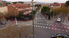 Hill side streets at Barcelona, long slide shot, camera move above junction Stock Footage