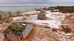 Three abandoned cottages adorn a hilltop in Door County, Wisconsin - stock footage