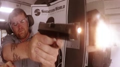 Front view of man shooting pistol Stock Footage
