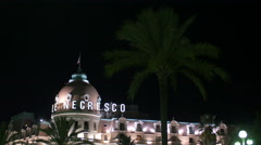 Le Negresco Hotel in Nice at night Stock Footage