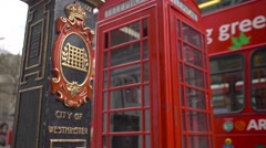 Red iconic phone booth in london Stock Footage