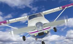 The Front of A Cessna 172 Single Propeller Airplane In The Sky. Kuvituskuvat