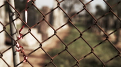 Rack Focus from Chain LInk Fence to Cemetery - Color Corrected - stock footage