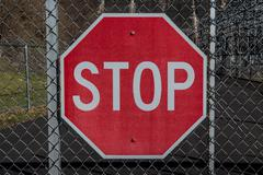 Stop Sign on Chainlink Gate Stock Photos