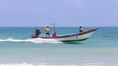 Thai men sitting in a boat travel in sea water at island Koh Phangan, Thailand Stock Footage