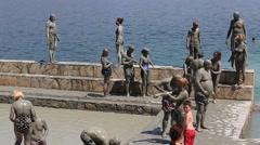 People are taking a mud bath.  Dalyan, Turkey Stock Footage