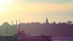 Ship sailing through landmarks of Istanbul.  - stock footage
