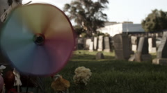Colorful Spinning Pinwheel at Grave Marker - Color Corrected Stock Footage