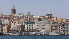 Architecture and Galata tower over the Golden Horn bay in Istanbul, Turkey Stock Footage